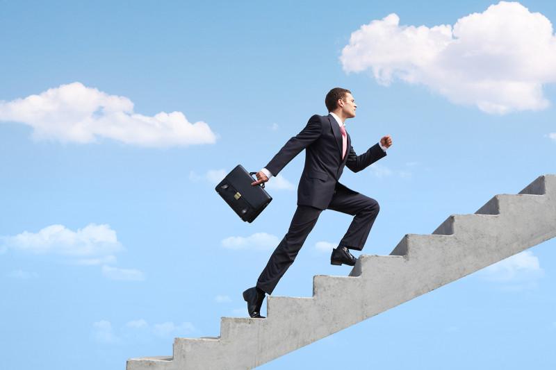 Confident-Businessman-Upstairs